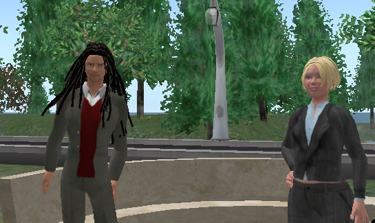 Chris Collins (left) talks with me in Second Life.