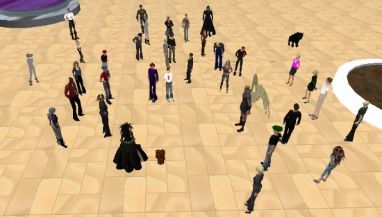 ReactionGrid COO Robin Gomboy (center, black dress) and CEO Kyle Gomboy (brown toaster to her right) speak at Train for Success in Second Life.