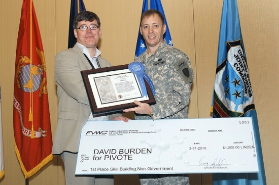 David Burden, receiving his winning prize for Daden's skills building entry of the U.S. Federal Virtual World Challenge from COL Langhauser, Director, U.S. Army Simulation & Training Technology Center. (Image courtesy Daden Limited.)