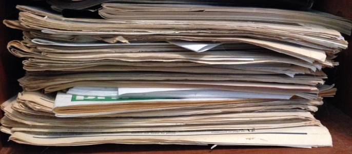 Not every stack of old newspapers is created equal. This one contains some of my articles, and I'm keeping it.