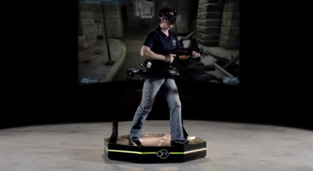 Creator Jan Goetgeluk demonstrates the treadmill, playing a first-person shooter with an Oculus Rift.