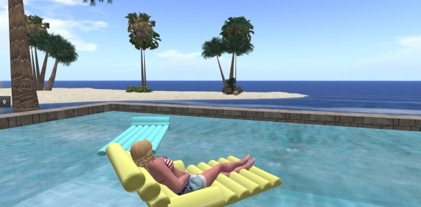 Lounging in the pool.