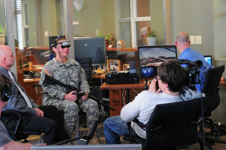 Sgt. Stephanie Bacon of the 191st Training Brigade demonstrates a virtual reality PTSD therapy for a documentary crew at Joint Base Lewis-McChord, Wash. ( Photo courtesy by Maj. Matt Lawrence, 807th MDSC Public Affairs)