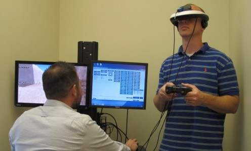 Marat Zanov, left, tests virtual reality hardware used in conjunction with USC-developed software to treat veterans suffering from PTSD. (Photo courtesy of Marat Zanov.)