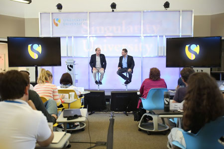 Singularity University's Co-Founders Ray Kurzweil (left) and Peter Diamandis (right) presenting inside the classroom. (Image courtesy Singularity University.)