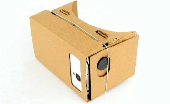 The first generation Google Cardboard headset with a magnet on the side.