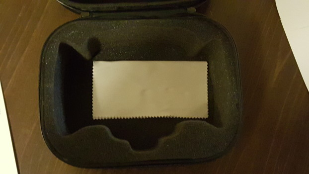 Padded carrying case, with lens cloth.