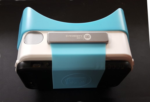 The Dscvr headset's stretchy band can fit over a variety of smartphones -- and their protective cases.