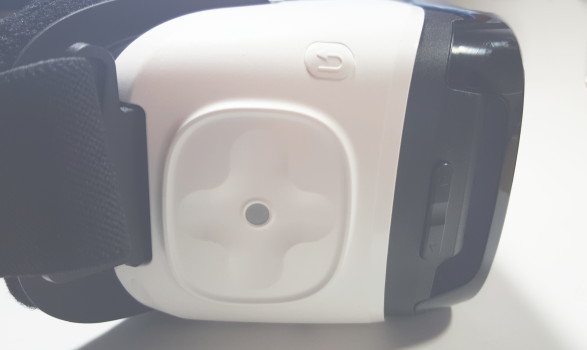 Gear VR controls: touchpad, white back button above touchpad, black volume button to right.