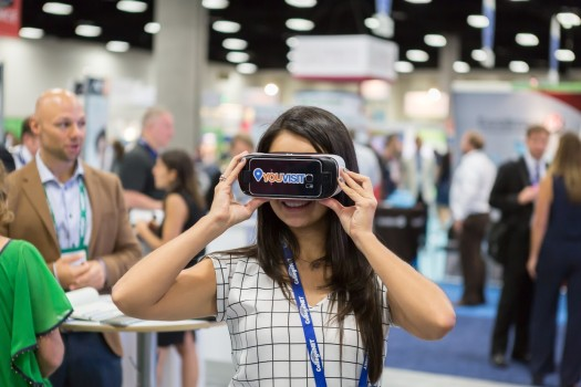 Woman views YouVisit VR experience through Gear VR headsets. (Image courtesy YouVisit.)