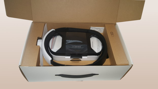 Custom-cut cardboard to protect it during shipping, with protective plastic film covering the lenses.
