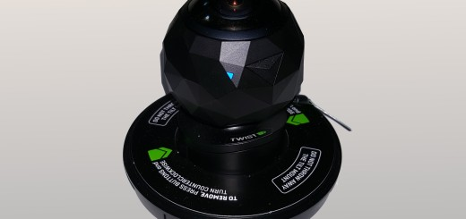 The 360fly on one of its mounts. The blue LED light indicates that the camera is on and ready.