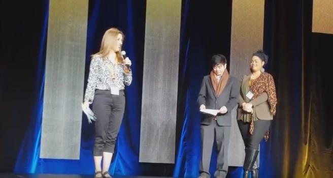 Crista Lopes accepting award.