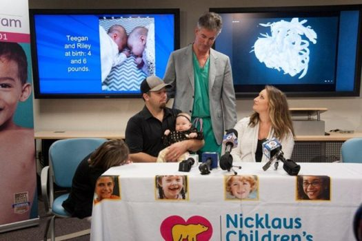 Dr. Burke with Cassidy and Chad Lexcen, parents of twins Teegan and Riley, as well as Harper, 6 and Asher, 3. (Image courtesy Nicklaus Children's Hospital.)